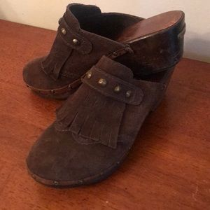 Used Michael Kors wooden clogs. Size 7. Super fun